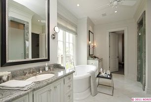 Traditional Master Bathroom with partial backsplash, Freestanding, Standard height, Bathtub, Raised panel, specialty door