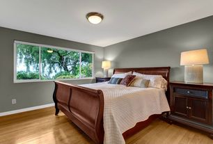 Modern Guest Bedroom with Hardwood floors, flush light