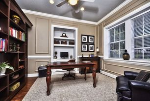 Traditional Home Office with can lights, Chair rail, Casement, Crown molding, Art desk, Carpet, Standard height, Wainscotting