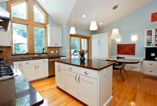 Traditional Kitchen with Transom window, Standard height, Framed Partial Panel, U-shaped, Wall sconce, Flat panel cabinets