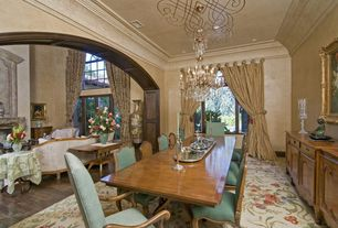 Traditional Dining Room with Built-in bookshelf, Chandelier, Carpet, Crown molding