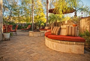 Tropical Patio with exterior stone floors, Fence, Fire pit, Pathway