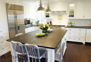Modern Kitchen with Pendant light, Soapstone counters, Hickory Hardware Williamsburg 3 in. Cup Pull, Glass panel, L-shaped