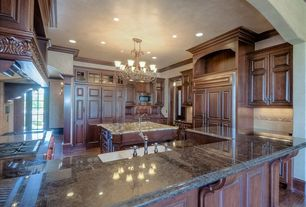 Traditional Kitchen with Hardwood floors, Chandelier, built-in microwave, can lights, full backsplash, Custom hood, Flush