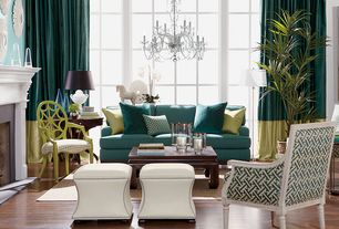 Traditional Living Room with Chandelier, High ceiling, Cement fireplace, Laminate floors, Ethan Allen Sunburst Mirror