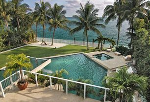 Tropical Swimming Pool with Pathway, exterior stone floors, Contemporary metal railing with steel rods, Fence, Fountain