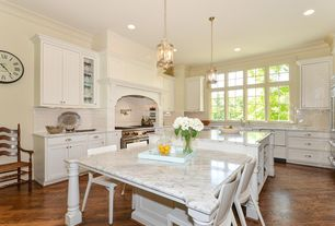 Traditional Kitchen with Standard height, double oven range, Breakfast nook, Glass panel, can lights, Crown molding, Casement