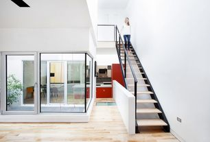 Contemporary Staircase with Hardwood floors, Cathedral ceiling, Metal staircase