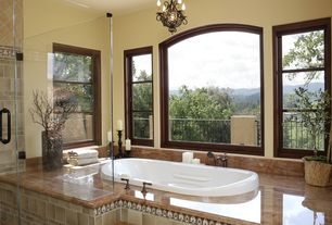 "Mediterranean Master Bathroom with Balcony, Spa Escapes Antigua Waterfall 70"" x 41"" Whirlpool Jetted Bathtu, Pendant light"
