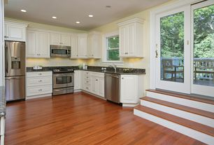 Traditional Kitchen with Simple granite counters, Simple Granite, Laminate floors, L-shaped, Raised panel, Undermount sink