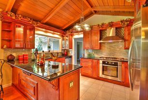 Cottage Kitchen with Raised panel, full backsplash, dishwasher, wall oven, can lights, Complex Granite, stone tile floors