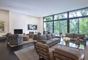Contemporary Living Room with Emerald home furnishings channing round cocktail ottoman in silver grey fabric, Hardwood floors