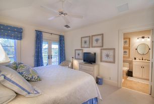Traditional Master Bedroom with Ceiling fan, Carpet, Crown molding, French doors