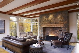Rustic Living Room with Fireplace, Casement, Standard height, can lights, Exposed beam, stone fireplace, Laminate floors