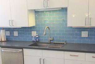 Modern Kitchen with Soapstone counters, Tilebar loft blue gray polished 3x6 glass tile, Ultracraft Destiny Seneca Cabinetry