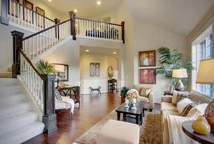 Traditional Living Room with Standard height, Casement, Paint, Hardwood floors, Loft, Mirrored credenza, Wainscotting