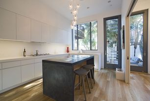 Modern Kitchen with Soapstone counters, High ceiling, Kitchen island, can lights, French doors, specialty window, Flush