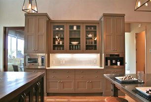 Craftsman Kitchen with full backsplash, Stainless steel counters, Pendant light, French doors, Soapstone counters, Paint
