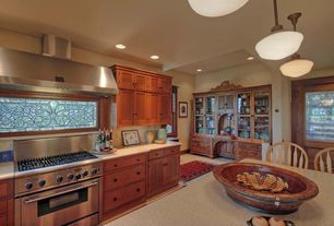 Craftsman Kitchen with Pendant light, Stainless Steel, One-wall, Vinyl floors, Breakfast nook, Flat panel cabinets