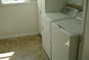 Traditional Laundry Room with Built-in bookshelf, stone tile floors, Casement, Standard height, specialty door, Wainscotting