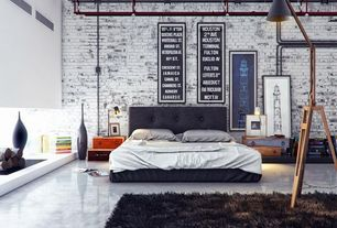 Contemporary Master Bedroom with Built-in bookshelf, High ceiling, Pendant light, interior brick, simple marble floors