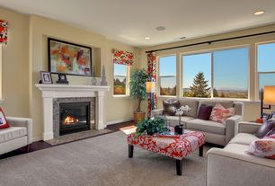 Contemporary Living Room with Neutral sofa, Hardwood floors, Saskia Floral Ottoman (Discontinued), Red accents
