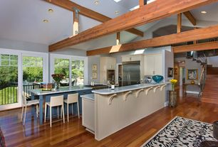 Contemporary Kitchen with Skylight, High ceiling, Flat panel cabinets, Kitchen island, Breakfast bar, Exposed beam, U-shaped