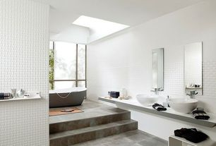 Contemporary Master Bathroom with Bathtub, Freestanding, Wall Tiles, Corian counters, Standard height, limestone tile floors