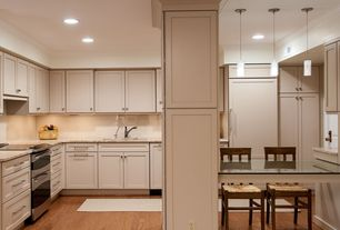 Modern Kitchen with Built In Panel Ready Refrigerator, Multiple Refrigerators, Simple granite counters, wall oven, can lights