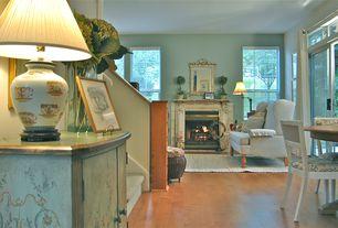 Cottage Living Room with French doors, Lumber liquidators sycamore honey laminate flooring, Cement fireplace, Hardwood floors