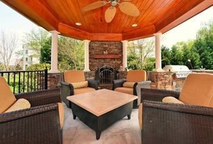 Tropical Porch with exterior stone floors, Screened porch, Deck Railing, Outdoor kitchen