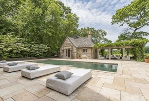Contemporary Swimming Pool with Raised beds, Trellis, exterior stone floors, French doors