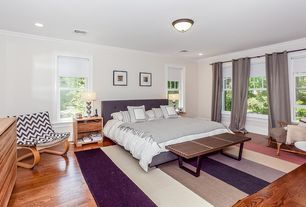 Contemporary Master Bedroom with flush light, double-hung window, Crown molding, Hardwood floors, can lights, Standard height