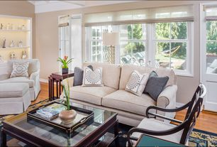 Traditional Living Room with Exposed beam, Built-in bookshelf, HGTV Home Modern Heritage Arm Chair Noire, Hardwood floors
