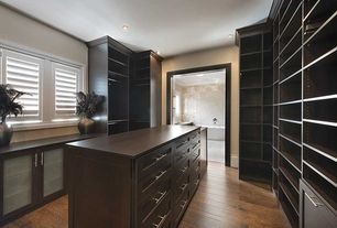 Contemporary Closet with can lights, Hardwood floors, Crown molding, Standard height, Built-in bookshelf