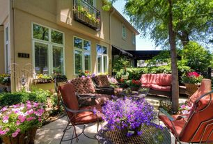 Traditional Patio with exterior awning, exterior concrete tile floors, Casement, French doors, exterior tile floors