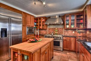 "Modern Kitchen with Flat panel cabinets, Stone Tile, John boos 1.5"" thick blended maple countertop - 25""w, U-shaped, Flush"