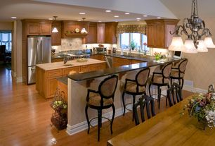 Traditional Kitchen with Stonemark Granite-Granite Countertop in Absolute Black, Kitchen island, Breakfast bar, Pendant light