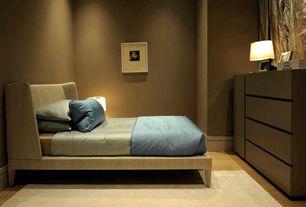 Contemporary Guest Bedroom with Hardwood floors, Built-in bookshelf