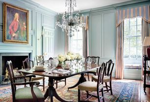 Traditional Dining Room with Standard height, Wall sconce, six panel door, insert fireplace, Chair rail, Hardwood floors