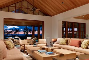 Tropical Living Room with Paint, Clear grain red cedar ceiling paneling, 18 inch cherry oval bowl, Ceiling fan, can lights