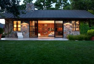 Contemporary Exterior of Home with Sponeck chair modern garden chair, Sliding doors, Exterior stone siding
