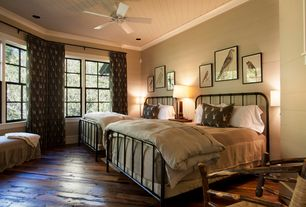 Country Guest Bedroom with can lights, double-hung window, Hardwood floors, Standard height, Crown molding, Ceiling fan
