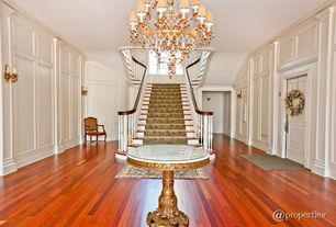 Traditional Staircase with Wainscotting, Chandelier, six panel door, curved staircase, Carpet, Standard height, Crown molding