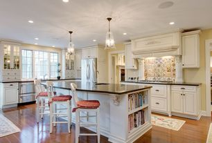 Traditional Kitchen with Undermount sink, Breakfast bar, Soapstone counters, Raised panel, Kitchen island, Specialty Tile