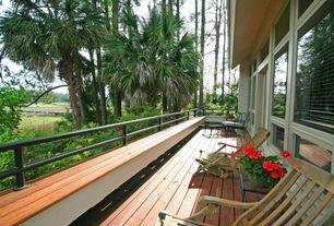 Contemporary Deck with UltraShield Voyager Series 0.9 in. x 5.5 in. x 16 ft. Hollow Composite Decking Board in Peruvian Tea