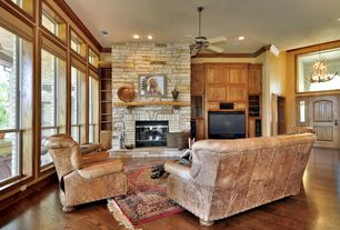 Eclectic Living Room with High ceiling, insert fireplace, Laminate floors, double-hung window, Fireplace, six panel door