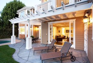 Traditional Patio with Casement, Deck Railing, Trellis, exterior stone floors, French doors