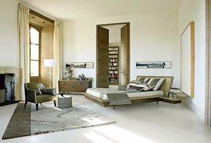 Contemporary Master Bedroom with specialty door, terracotta tile floors, Arched window