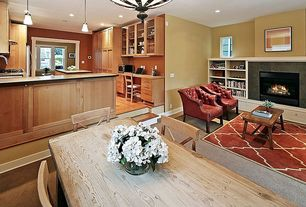 Contemporary Great Room with Cement fireplace, Pendant light, Built-in bookshelf, Hardwood floors